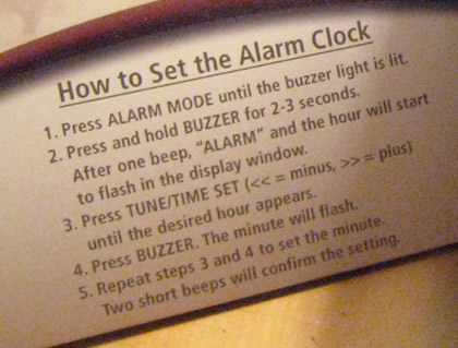 Complicated instruction card for setting an alarm clock.
