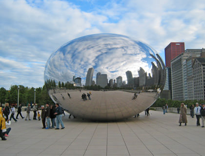Cloud Gate sculpture... a giant 'coffee bean' shape with a mirrored surface reflecting the Chicago city skyline.