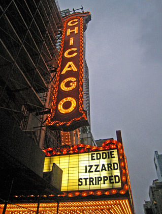 The marquee of the Chicago Theater showing Eddie Izzard Stripped.