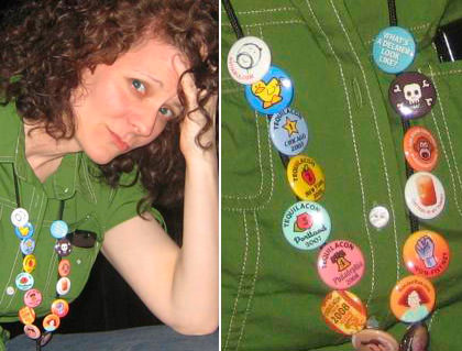Jenny wearing buttons that have been pinned to her name badge lanyard.