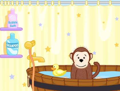 Webkinz monkey taking a bath with his rubber ducky.