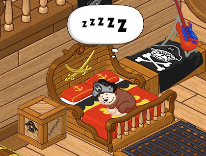 Webkinz monkey sleeping on his pirate-themed bed.