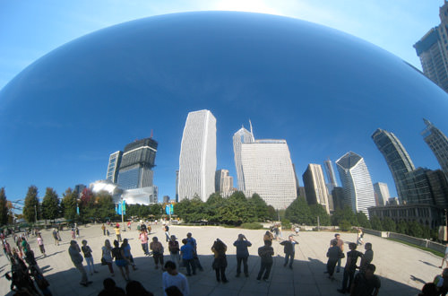 Photo of the Cloudgate sculpture reflecting Chicago skyline