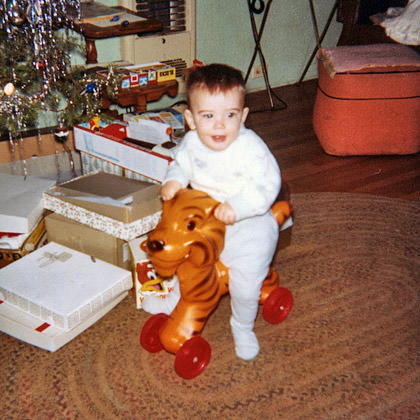 Baby Dave Rides a Plastic Tiger