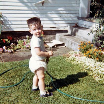 Baby Dave with a Garden Hose