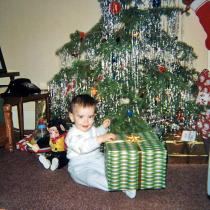 Baby Dave with a Christmas Present