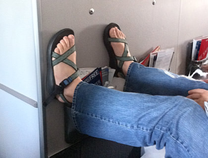 Feet on the Airplane Wall