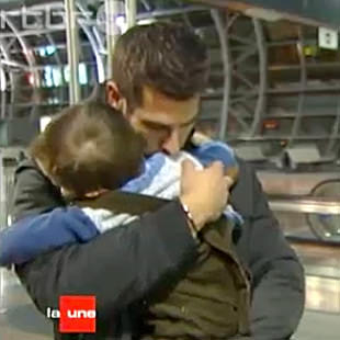 Laurent Ghilain hugs his son Samuel