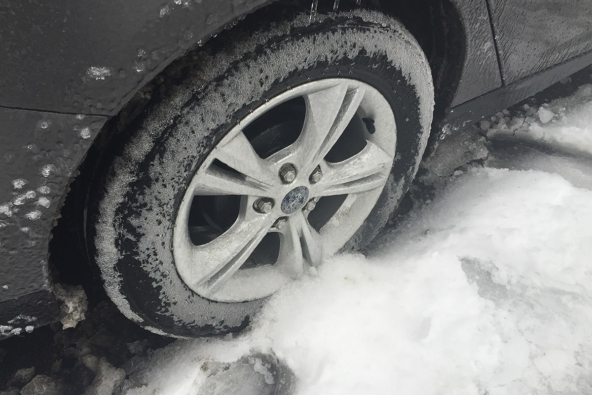 Tires frozen in the snow.